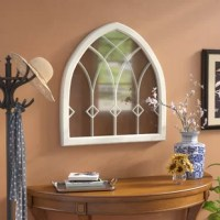 Able to open up a room, let the bright light bounce around, and add style to your space, mirrors are must-haves for rounding out a variety of ensembles. Take this mirror, for example: taking inspiration from chapel windows of yesteryear, this piece is crafted from a resin frame and features an arched silhouette. Inset accents break this piece up for a look sure to grab glances. Measuring 28.75'' H x 27.75'' W x 1.5'' D, it's perfect for capping a console or joining a larger gallery wall.