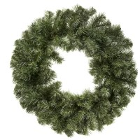 Its plain Christmas wreath exterior is ready to be decorated with ribbon and ornaments.