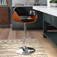 Lend a mid-century modern touch to the kitchen island or home bar with this stool. Founded atop a pedestal base crafted from metal, it showcases a curving seat made from walnut veneers. For comfort, the seat and back are wrapped in faux leather and filled with foam to comfort you as you lounge with breakfast or a homemade cocktail. Plus, this chair is adjustable, so you can find the perfect angle every time.