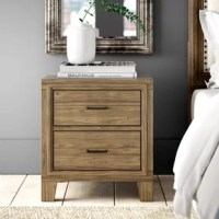 Pairing a clean-lined silhouette with a light oak finish, this stylish nightstand offers a contemporary appearance with a rustic twist. Crafted from solid and manufactured wood, its frame is founded atop four angled block feet for a nod to mid-century style. Measuring 24'' H x 22'' W x 16'' D, it includes two drawers, each with a bar pull for a touch of industrial appeal. Assembly for this product is required.