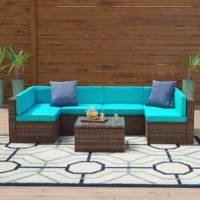 Make the most of your outdoor space with this seven-piece sectional seating group, a great place to kick back with a book or enjoy a meal with friends under the stars. Each item features a steel frame wrapped in resin wicker for a weather-resistant look that lends your space tropical appeal, while polyester blend cushions create an inviting spot to sit. The table features a tempered glass top and plenty of room for snacks and drinks.