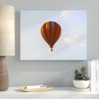 Gallery wrapped canvas print features a poly-cotton blend that is specially optimized for bright, vibrant colors. A chemistry perfect gloss finish protects against moisture and harmful UV rays.