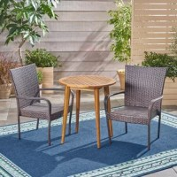 The beautiful blend of wood and wicker comes to life with this Outdoor 3 Piece Bistro Set. Complete with two wicker chairs and one wooden table, you can enjoy eating in your backyard whenever you want. The wooden table is treated to withstand even the harshest of seasons, ensuring your set looks great all year long.