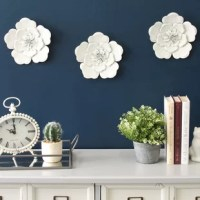 Create a gallery-worthy display on any bare wall with this handcrafted three-piece flower wall decor set! Made from metal in a premium hand-painted finish for an artisanal feel, each piece strikes a contemporary flower silhouette featuring five scalloped outer petals and smaller, blossoming inner petals. This trio arrives fully assembled and ready to hang right out of the box with a keyhole pre-installed for effortless installation.