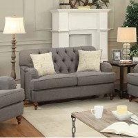 This loveseat features a diamond tufted backrest, tight back and loose seat cushions. The dark gray fabric with brown wooden bun legs in the front and wooden legs , alongside the English curved arms this loveseat is the essence of class and style. Two pillows are included for extra comfort and back support. Add this loveseat to any living room for the perfect centerpiece. Fully assembled.
