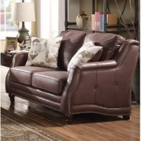 This collection is soft upholstered in a chocolate fabric, solid wood frame, loose back and seat cushions, rolled arms, nail-head trim and wooden turned-bun legs. This collection will be most relaxing area in your fast pace life.