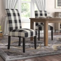 Rounding out your decor while providing sensible seating arrangements in small spaces, side chairs offer style and versatility to any interior design. Take this one for example: Crafted from a solid wood frame, it's founded atop four straight legs and sports 100% cotton upholstery with a two-tone plaid pattern. Plus, it features foam-filling for added comfort.