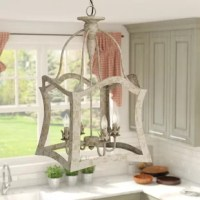 Looking for the perfect touch for brightening up an entryway or kitchen island? A chandelier like this is perfect for washing a specific space in light while delivering on-trend, floral-inspired style. Crafted from an openwork metal shade with a distressed white finish, this luminary supports four 60 W candelabra lights (bulbs not included) on floral-inspired stands for a touch of old world character. And since this piece is dimmable, it allows you to adjust your ambiance to suit the mood....