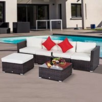Create the perfect outdoor ensemble for soaking up the sun and enjoying better weather with this six-piece sectional set like this! Featuring armed chairs and two armless seats, as well as an ottoman, this six-piece set is crafted from steel wrapped in resin wicker for a weather-resistant touch designed to live outdoors. Nine included cream white cushions lend each seat a padded touch, while the included coffee table is capped with a tempered glass surface for an easy-to-maintain breezy touch.