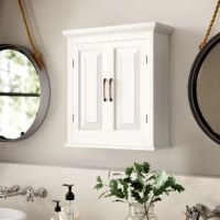 Let's be honest; most bathrooms are suffering from storage space. Fill in bare walls and clear up bathroom clutter without sacrificing prime real estate on your floors with this wall-mounted cabinet. Made from manufactured wood in a versatile white finish, this compact piece fits easily on any open space on your wall. Two doors with classic paneling open to reveal interior shelving for toiletries, spare soaps, and other essentials. Assembly is required, and mounting hardware is included.