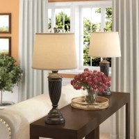 More than just illumination for your abode, table lamps lend artful appeal to your space as they shine. Try adding one to your nightstand to give the master suite a mini makeover, or stage one atop the entryway console to greet guests with a warm glow. Take this one for example: crafted from metal, its frame features a twisting urn design and oil rubbed bronze finish. Up top, a single light is highlighted by a tapered fabric shade.