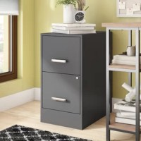 Crafted of steel in a classic baked enamel finish, this two-drawer vertical file strikes a clean-lined rectangular silhouette.  Set in soft-close, full-extension drawer glides, two high-sided drawers with plastic pull handles accommodate letter-sized hanging file folders, while the smooth top surface can be used for even more storage or display. Rounding out the design, a key lock on the lower drawer face secures both drawers.