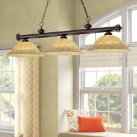 Not only ideal for hanging over your pool table to keep track of your game, this billiard light also fits in with any other area in need of some timeless charm. A metal bar suspended from a chain accommodates three 150 W bulbs (not included). Gold mottle shades round out the look, lending traditional charm while emitting a warm and inviting glow. A 72'' chain is included, so you can display this fixture at your desired height.