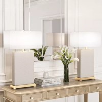 Add ambiance to your master suite, guest room, or den with this 29'' H table lamp. Made from metal, its rectangular base features a solidly-hued, woven texture, and a metallic hue at the bottom that is carried up through the top of the lamp. Its rectangular, white, 100% cotton shade conceals one included 13 W CFL bulb. This luminary arrives in a set of two, perfect for flanking couches or beds!
