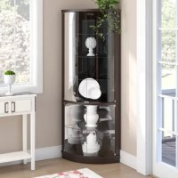 Give your keepsakes and fine china the vaunted position they deserve with this curio cabinet, a must-have for any home with wow-worthy collections. Crafted from a blend of solid and manufactured wood, it showcases a curved front while the back boasts a 90° angle - making it the perfect pick for rounding out the corner of any room. Four glass doors open to reveal five shelves inside for storing treasured trinkets. Plus, an integrated LED light brightens up your ensemble.