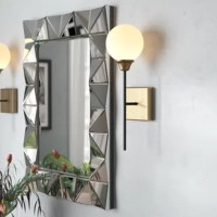 Perfect for you bath or powder room, this wall sconce is an ideal option for adding some light in your life. Featuring a single milk glass orb with brass detailing at the base, this light adds a contemporary feel to any room. Its black post attaches to a square wall fixture, which can be mounted with the bulb facing up or down depending on your needs. A dimmable feature allows you to set the perfect mood for your space when paired with a compatible switch, adding a splash of personality.