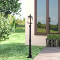 Vintage industrial design plus sleek, urban style creates this portable post lantern. With all the appearance of an antique streetlight, this post lantern will brightly illuminate your backyard with an area-filling glow. This tall post is finished in a matte white and features subtle nods to Art Deco design with its flared, angular base and clean lines. A frosted white shade doubles as a bulb shield, keeping the bulb and other electrical components nice and dry while brightly diffusing light....