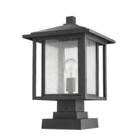 Add to the craftsman personality of exterior space with this product. A charming village motif transforms sleek finish in a dual frame over a seedy glass shade.
