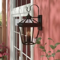 Outdoor lighting is a crucial step when it comes to putting together your home: Not only does it make your home safer, but it offers a touch of curb appeal, and helps set the tone for your home decor right from your front door. This piece, for example, is a lantern-inspired touch that's perfect for any traditionally-minded home. Made of  metal with glass panes, it features four 40 W candelabra lights (bulbs not included) for a charming touch of yesteryear. And since it's designed with wet...
