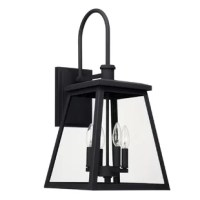 Defined by a trapezoidal profile, the 4-light outdoor wall lantern offers distinguished charm and character for many home styles, from the country cottage and transitional to rustic industrial and everything in between.