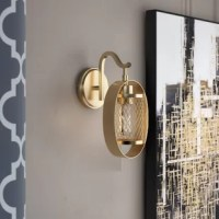 Bring some enhancing illumination to your walls with this one-light armed wall sconce. A contemporary silhouette, this sconce offers glam-inspired style. Made of metal, this hardwired luminary is in a drum shape, with a diamond geometric open-work pattern around the cylinder, and is at home in modern or glam aesthetics. This piece is perfect for a living room, vanity, or as a bedside lamp in the bedroom. This piece accommodates one bulb of up to 100 W (bulb not included).