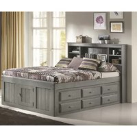 Add much needed storage to your child's bedroom with this bed. Made from solid pine wood in a weathered gray finish, this bed has shiplap paneling on the headboard and footboard for timeless appeal. The bookcase headboard has five open cubbies where your kid can keep books and stuffed animals close-by. For even more storage, the base of the bed has 12 drawers of storage – six per side – where you can keep clothes or spare blankets. Plus, a door is located in the footboard that opens up...