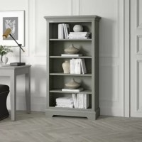 Though always an ideal spot to keep your reads, this bookcase isn't only for housing novels. Measuring 60'' H x 32'' W x 14.5'' D, it includes five shelves for everything from framed family photos to baskets filled with accessories. Plus, it lends stately style to your study or master suite with its solid and manufactured wood frame showcasing molded trim and a neutral solid finish. Assembly for this product is required.