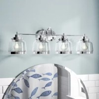 Designed to live in damp areas, like bathrooms with steamy showers, this vanity light is safe to shine over your sink. Crafted from metal, its frame features a rounded backplate and a tubular bar all finished in a versatile metallic tone. Its four lights are each highlighted by clear glass shades to cast a warm glow.