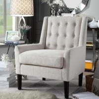 Add comfortable, stylish seating to your home with this upholstered tufted button accent chair. The deep handcrafted button tufting gives the back a touch of character. Upholstered with fine velvet with a tight back, it is foam cushioned for total comfort and relaxation. Use this chair to fill that empty spot in the room, combine it with a throw pillow and blanket to finish this cozy addition.