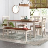 Set a classic foundation in your eat-in kitchen or dining room with this six-piece dining set. The rectangular table that anchors the set features a butterfly leaf so your tablescape can grow alongside your guest list, while four armless chairs and a matching bench round out the collection and provide seating for six. Crafted from solid Asian hardwood, these versatile designs showcase clean lines and a neutral two-toned finish, allowing them to blend with a variety of color palettes and...