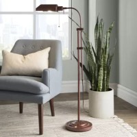 Ideal for reading nooks and living rooms alike, this 59'' floor lamp brings both styles and shine to your space. Crafted from metal with a brushed finish, its frame features a dual-arm design and an arched silhouette for a traditional look. Up top, a single light is highlighted by an angled shade to evenly distribute a warm glow throughout your ensemble. The manufacturer for this product provides a limited one-year warranty.
