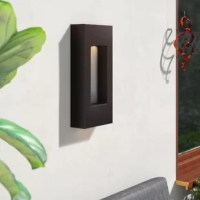 Illuminate any outdoor arrangement in contemporary style with this 4-Light Outdoor Sconce. Rated for wet locations, this metal fixture features a boxy silhouette with a recessed center in a versatile bronze finish that blends easily with a variety of color palettes and aesthetics. Four compatible 35 W GU10 bi-pin halogen bulbs, so you can skip a trip to the hardware store and boost the brightness in your space as soon as this design is installed.