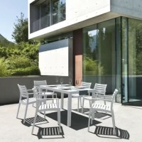 Gear up for weekend brunches and backyard BBQs under the sun with this seven-piece dining set, complete with one rectangular table and six stackable armchairs. Crafted from polypropylene resin in a neutral finish, each piece resists weather, water, and UV with minimal maintenance (just wipe clean as needed). Slatted accents let the rain run right through so water won't pool after showers. The manufacturer backs this set with a two-year limited warranty in residential settings, as well as a...