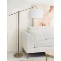 This minimalist metal floor lamp showcases a sleek slim-line design, a stylish modern finish, and a tapered drum shade wrapped in beautiful linen. Whether it's set behind the couch, sitting next to your bed, or stationed in the office, this lamp's minimalist appeal can work anywhere.