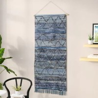 From creating stunning focal points to completing bedspreads and tablescapes, tapestries tell a story – what's yours? This wall hanging, for example, is perfectly at home in modern and contemporary aesthetics, and can be hung alone to break up a bare wall, or as part of a bigger gallery wall. Crafted from a blend of cotton and silk materials, in multi color – this oversized piece measures 60'' H x 30'' W.
