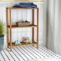 Bathrooms don't always have the amount of storage we're looking for. That's where this freestanding shelf comes in: it has three shelves to organize your belongings, from toiletries to cleaning supplies to folded towels. It's crafted from solid bamboo in a natural brown hue and features slatted shelves for a look that complements a variety of aesthetics, especially powder rooms with rustic and cottage vibes.