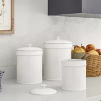 When decorating your home, it's always considered a touchdown when something is both fashionable and functional – like this three-piece canister set for example! Crafted from ceramic, each piece is food safe and lead free with a rubber, air-tight seal that is designed to keep its contents fresh. Plus, awash in a glossy white glaze, each piece features an earthenware finish for just a touch of country cottage appeal in your arrangement.