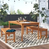 Make any meal more memorable by bringing it outdoors with this three-piece dining set. Crafted from solid teak wood, this set includes one rectangular table and two backless benches in a warm brown finish that resists weather, water, and UV. Slatted details let rain run right through so water won't pool, while an umbrella hole in the center of the table gives you the option to add shade. Assembly is required. The manufacturer backs this set with a one-year warranty.