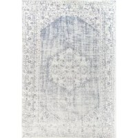 """The dainty and divine Suri rug from this Claire Collection is giving us total rug envy. The delicate blue and white floral motif on this stunner complement the rug's easy, low pile and soft texture. Plus, this style is made to work both indoors and outdoors thanks to its unique materials and extra-durable weave. Can you say """"must-have""""?"""