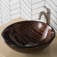 The copper-brown hue of the Gaia Glass Vessel Sink gives it an earthy appeal, while the layered texture highlights the artistry of the glass. Each tempered glass Nature Series™ bathroom sink is handcrafted in a very labor-intensive process. Starting with only the finest materials, artisans work each sink through its various production stages. By using hands to get the work done, every Kraus sink becomes a functional work of art that has seen the great care and thought put into its creation....