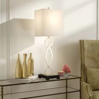 Illuminate an end table in the den or make your master suite nightstand shine while also adding style with this eye-catching lamp. Crafted from metal, it features an openwork trellis base measuring 36.5