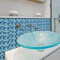 Brighten up your kitchen and bathroom with these faux ceramic tiles. With a colorful blue mosaic pattern, these peel and stick tiles have a fresh and clean look.