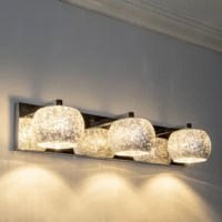 This 3-Light Vanity Light update the look of your bathroom with the contemporary-meets-glam stylings of this vanity light. The clean, modern lines of the backplate and arms are softened by the glass globe shade. Finished in a timeless tone, that compliments an array of home furnishings. Whether it's renovating an entire bathroom or only replacing a light fixture this vanity will revamp your bathroom, making it feel fresh and brighter.