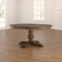 Anchor your dining room in a modern farmhouse style with this extendable dining table. Crafted of solid hardwood with natural oak veneers, the tabletop strikes a 48