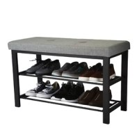 Help declutter the entryway or introduce a space to sit in the hall with this storage bench, multipurpose addition to almost any space. Its clean-cut frame is crafted from metal and features a seat wrapped in fabric upholstery. Subtle button-tufted details round out the design, while a pair of slotted shelves below accommodate up to eight pairs of your favorite kicks.
