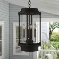 Illuminate your outdoor space in traditional style with this hanging lantern, a must-have for welcoming guests before you even make it to the front door. Crafted from metal, it features a versatile finish and traditional silhouette re-worked to fit in with modern aesthetics. A clear seeded glass cylinder shade helps to soften the glow of four 60 W bulbs (not included) as it lights up your porch. It features a 120'' chain.