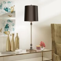 Bring a bit of brightness to your bedside table or make the entryway console shine with this 33.5'' lamp. Crafted from metal with a sleek finish, its frame features a clean-lined base and twisting body accented by crystals for a glint of glamour. Up top, a single light is highlighted by a tapered black shade, creating an even gleam throughout your ensemble. Requires one 60W bulb, which is not included.