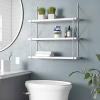 Introduce storage space and style alike to the bathroom, living room, or bedroom with this versatile accent shelf. Three tiers of shelves crafted from manufactured wood give you plenty of spots to set up decorative displays, keep small-scale essentials on hand and let you show off your favorite framed photos. Metal side braces take on an open, crisscrossing silhouette to lend this multipurpose item a look suited for contemporary spaces.