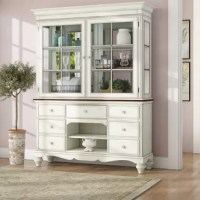 Steeped in pastoral charm, this buffet and hutch bring warm, lived-in character to dining rooms, living areas, and like spaces. It's built from solid wood in an old white finish with a hint of dark pine for a touch of contrast, while a decorative skirt, turned bun feet, and crown molding speaks to its craftsmanship. What's more, this accent brims with storage solutions – from the seven drawers and three shelves below to the interior shelves up top behind the mullion glass doors.