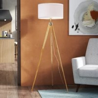 Brimming with mid-century character, this floor lamp brings both style and brightness to retro and modern ensembles alike. Its base, crafted from wood, strikes an on-trend tripod silhouette with tapered legs that draw the eye to a white fabric drum shade that evenly spreads the glow of a single 60 W maximum bulb throughout your space. Plus, this luminary is compatible with energy-saving LED bulbs, so you can truly customize your decor.